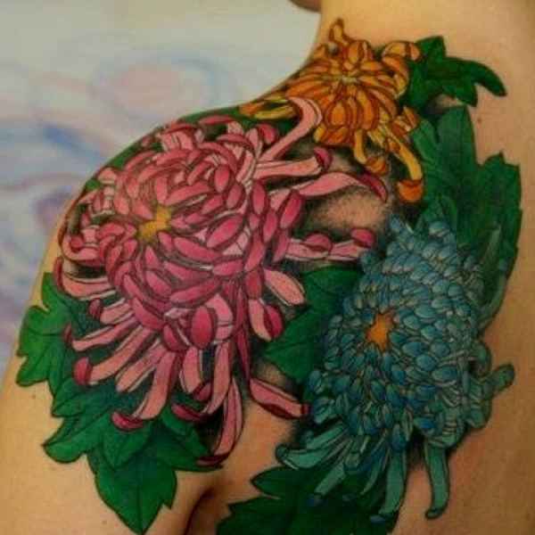 fantastic chrysanthemum shoulder tattoo on chest With colourful ink For Man And Woma