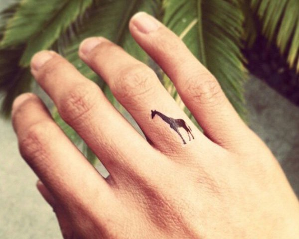 Great Giraffe Tattoo On Finger With Black Ink For Man And Woman