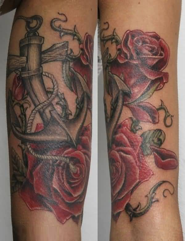 great red and black color ink anchor tattoo on boy sleeve with rose