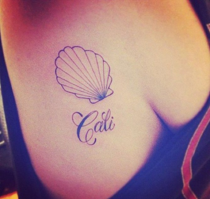 great shell tattoo on chest With Black ink For Man And Woman