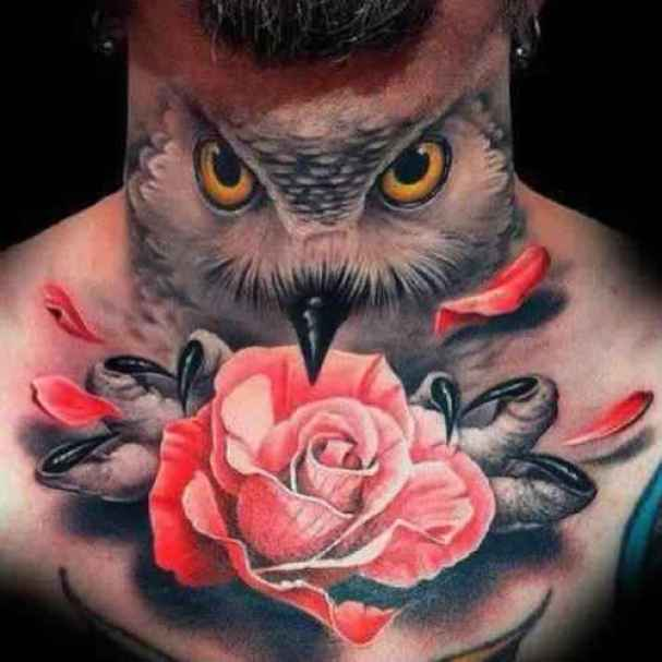 high defination red black and white color ink animated owl tattoo on boy's sleeve for boys only made by expert