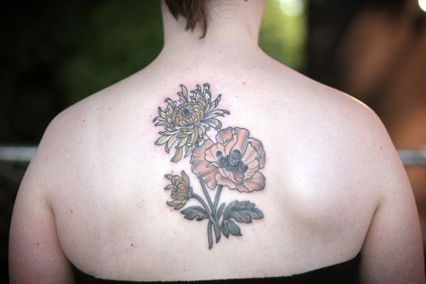 incredbly small chrysanthemum tattoo on back With black ink For Man And Woma