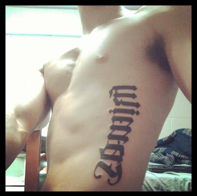 incredible black color ink ambigram tattoo for man on ribs side