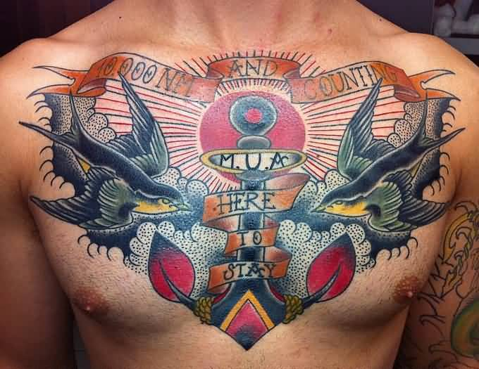 innovative red and black color ink anchor tattoo on boy chest made by expert