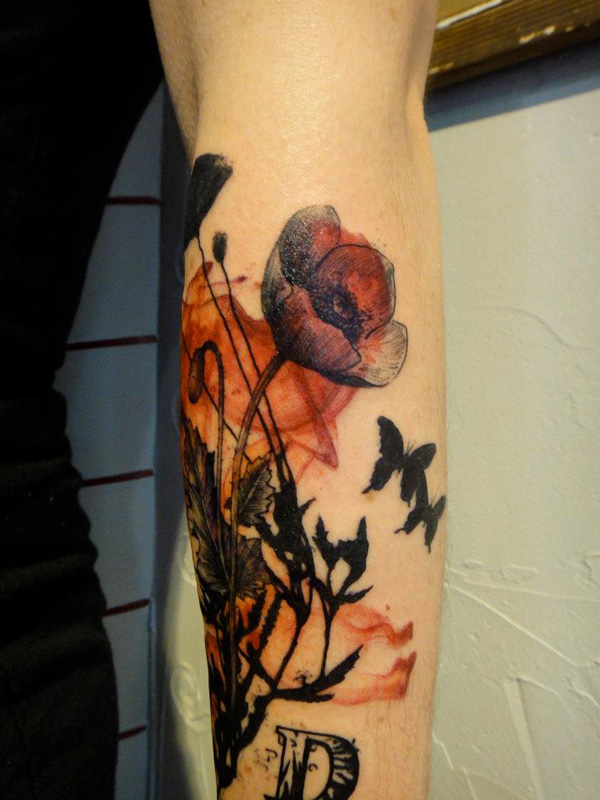 love able poppy tattoo on arm With colourful ink For Man And Woman