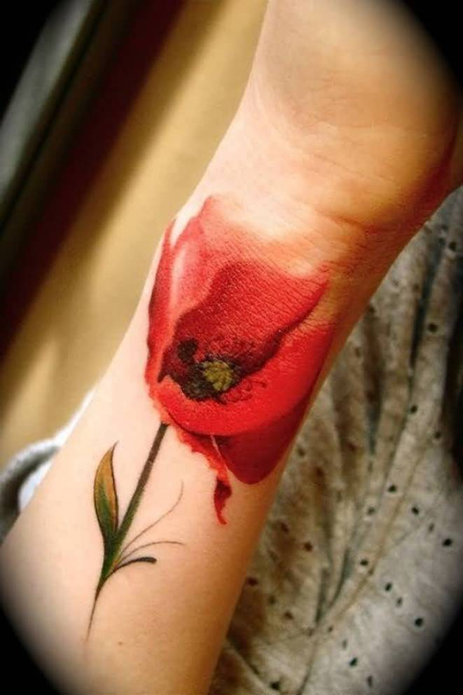 lovely poppy tattoo on foot With colourful ink For Man And Woman