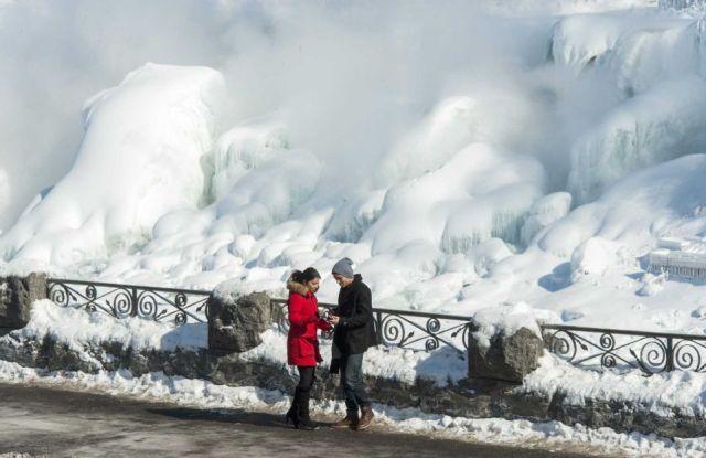 Man With Women Enjoying On The Niagara Falls