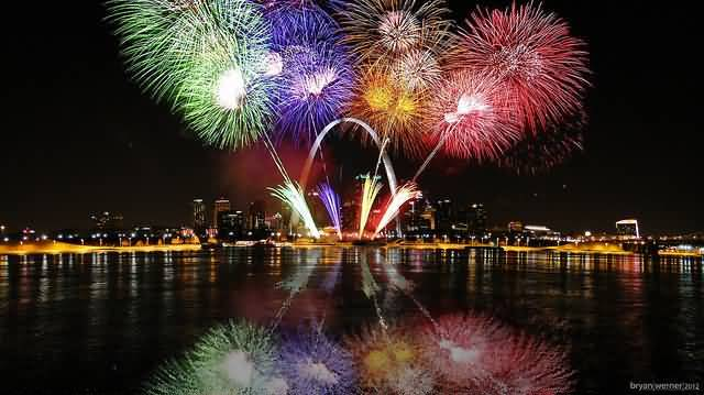 Many Color Of Fireworks On The River Near The Gateway Arch At Night Wallpaper