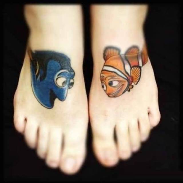 maori blue and yellow color ink animated leg tattoo on girl's foot for girls made by expert artist