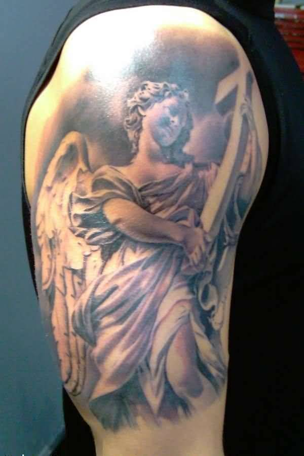 mind blowing gray and red color ink Angel Tattoos on boy shoulder made by expert artist