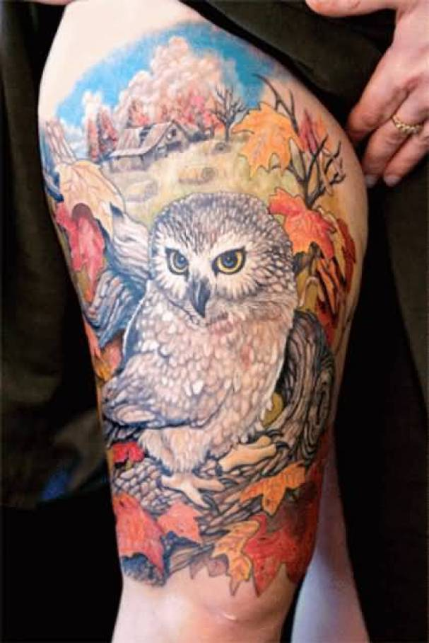 mind blowing red white and yellow color ink animated owl tattoo on girl's thigh for girls only made by expert