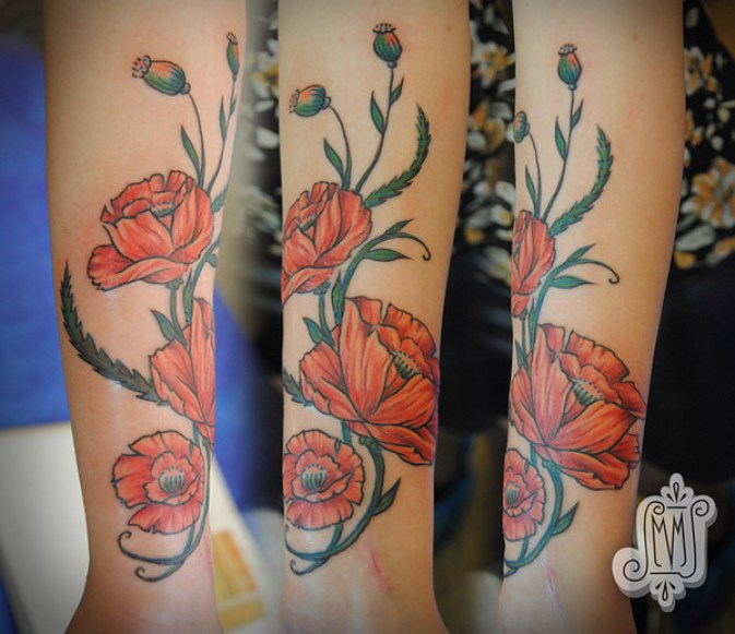 most amazing Poppies tattoo on wrist With colourful ink For Man And Woman