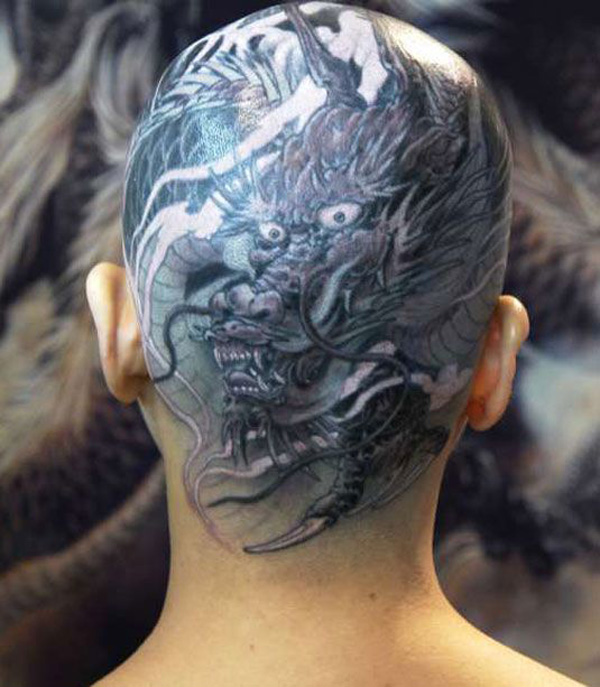 most dashing Japanese tattoo on the head With Black ink For Man And Woman