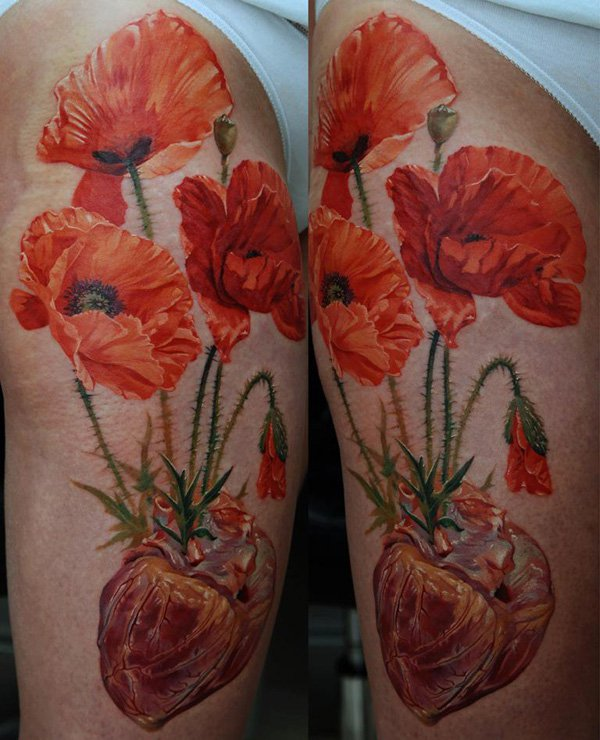 most incredible Poppies tattoo on thigh With colourful ink For Man And Woman