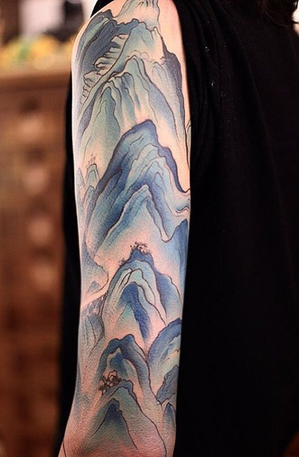 most incredible mountain tattoo on hand With Blue ink For Man And Woman
