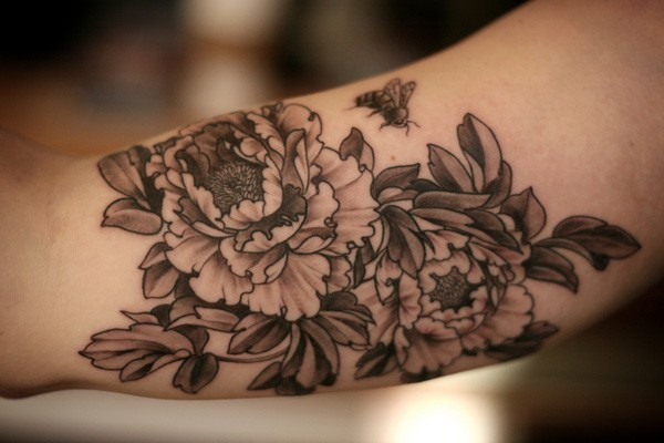 most unque Peony tattoo on wrist With Black ink For Man And Woman