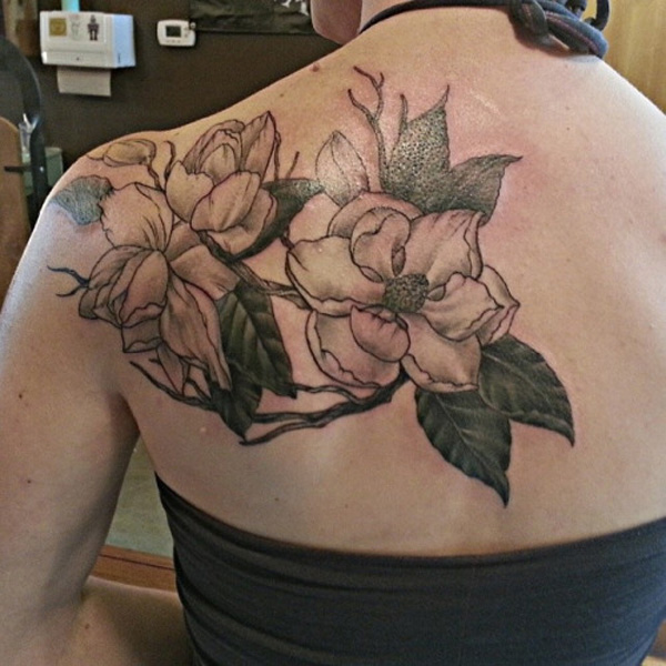 most wonderful magnolia back tattoo for women on back With colourful ink For Man And Woman