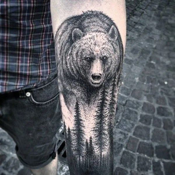 nice forest and bear tattoo on wrist With Black ink For Man And Woman