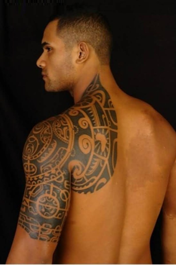 Nice Gray Ink Tribal Tattoo On Boy Shoulder