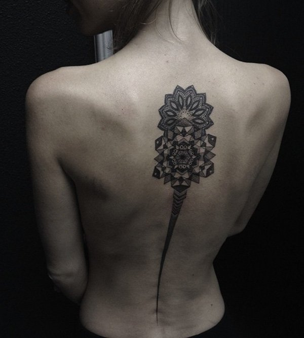 Oustanding Mandala Spine Tattoo With Black Ink For Woman
