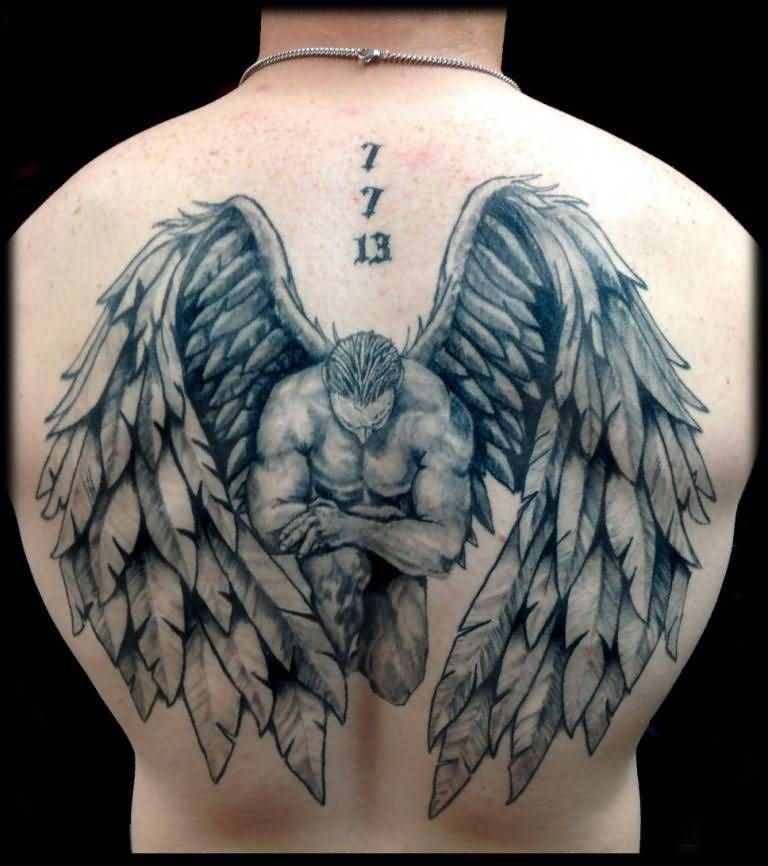 passionate gray and blue light color ink angel warrior tattoo on boy's full back cover for boys only made by expert artist