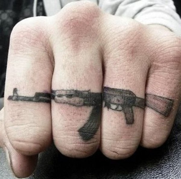 Phenomenal Gun Finger Tattoo With Black Ink For Man And Woman