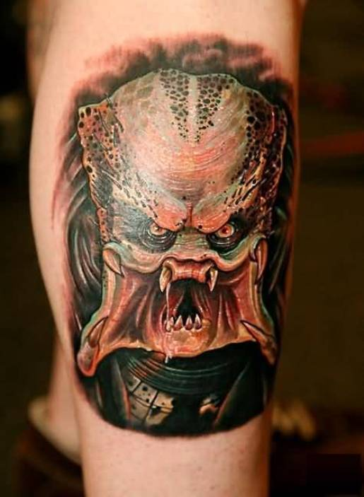 popular green and red color ink Predator Mouth Tattoo On Calf for boys