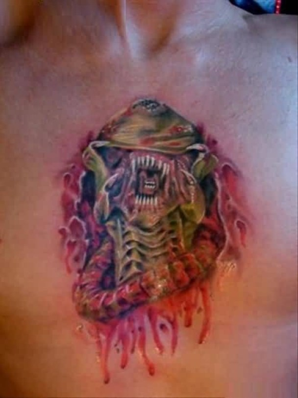 Realistic Red Color Ink Alien Tattoo On Ripped Chest For Man