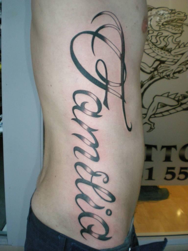 superb black color ink ambigram tattoo on men's rib for boys