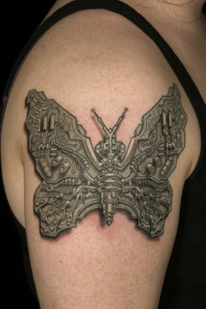 Superb Steampunk Butterfly Tattoo On Shoulder With Black Ink For Man And Woman