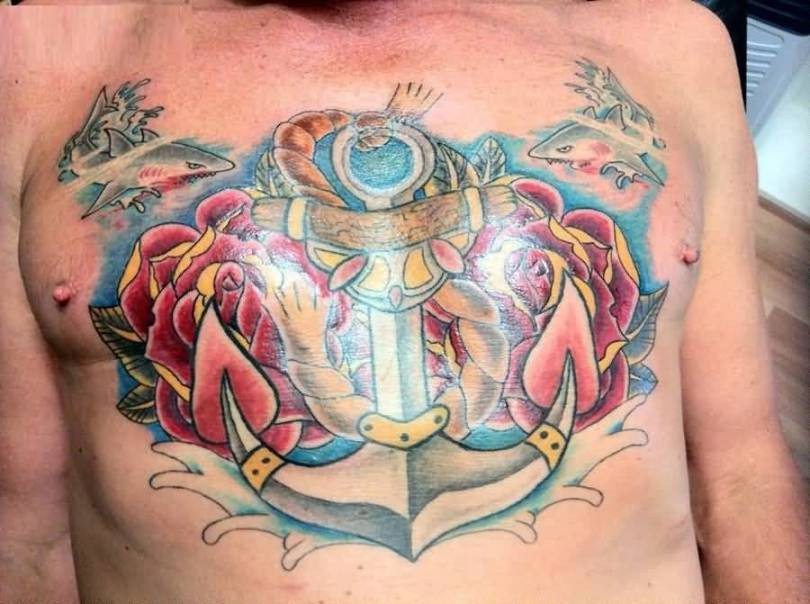 terrific red and blue color ink anchor tattoo on man chest with water seen