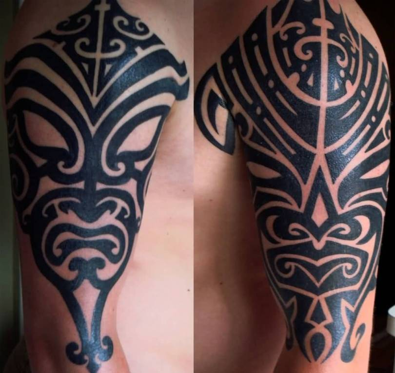 Traditional Dark Gray Color Ink Mask Tattoo Designs With Tribal Art On Boy Arm