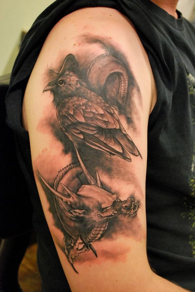 tremendous Raven and Dragon Tattoo on arm with Black ink For Man And Woman