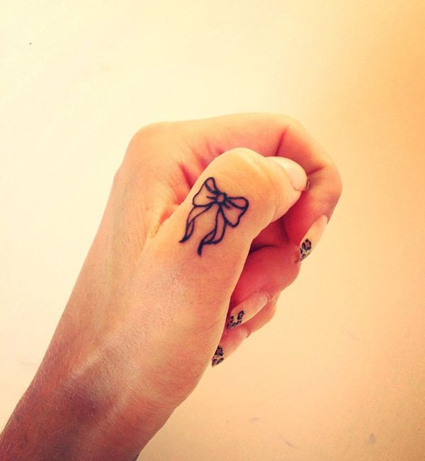 Trendy Bow Finger Tattoo. With Black Ink For Man And Woman