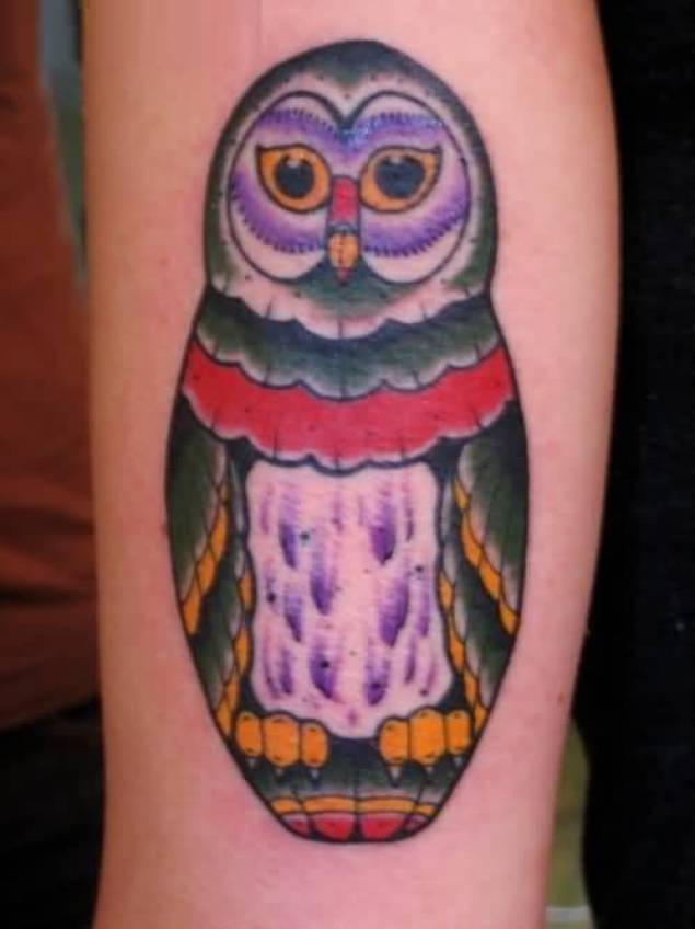 unique red yellow and green color ink animated owl tattoo on boy's sleeve for boys only made by expert artist