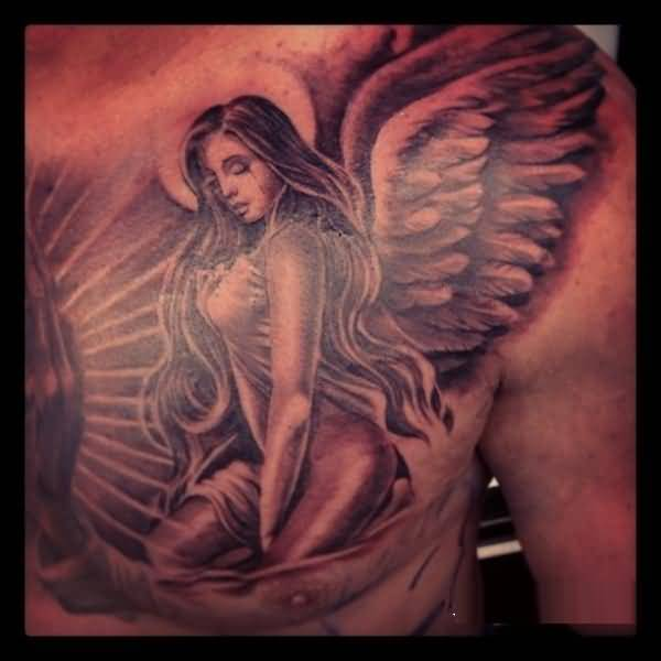 weird red and black color ink angel tattoo on boy chest for boys made by expert artist