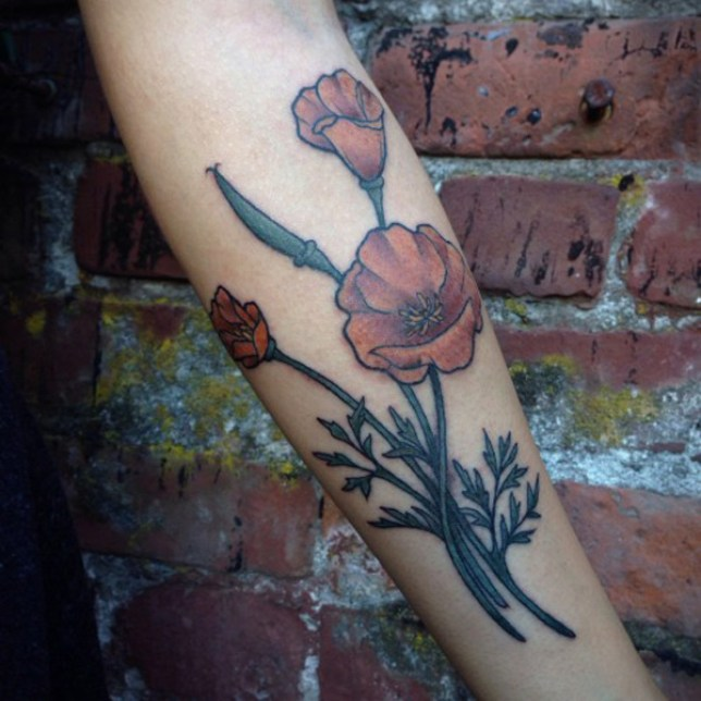 wonderful Poppies tattoo on wrist With colorful ink For Man And Woman