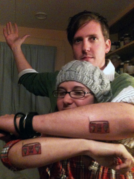 Adorable Red And Black Color Ink Boombox Couple Tattoo Design For Couple