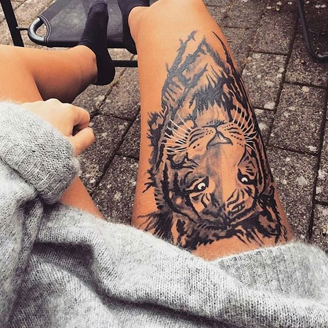 Amazing Tiger Face Tattoo On Thigh For