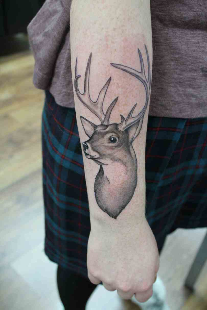 Amazing Wrist Tattoo Of DeerOn Elbow With Skirt