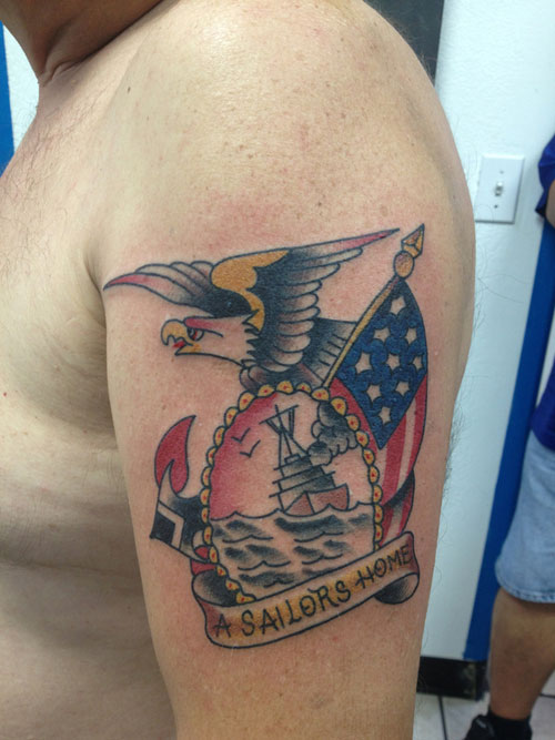 Attractive Blue Yellow Black And Red Color Ink American Flag Tattoo On Biceps For Boys