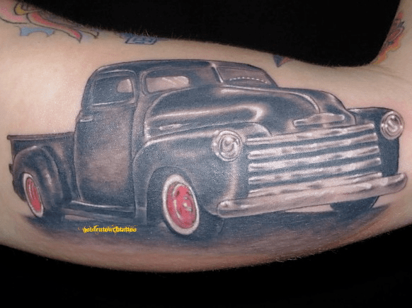 Awesome Black And Red Color Ink Car Tattoo On Muscles For Boys