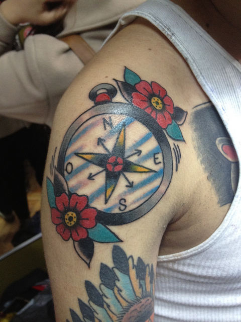 Awesome Blue Red And Black Color Ink Compass Tattoo On Shoulder For Boys
