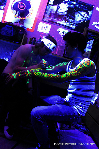 Awesome Green And Red Color Ink Making Blacklight Tattoo For Boys