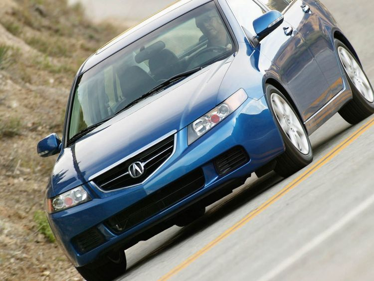 Awesome blue Acura TSX car on the road