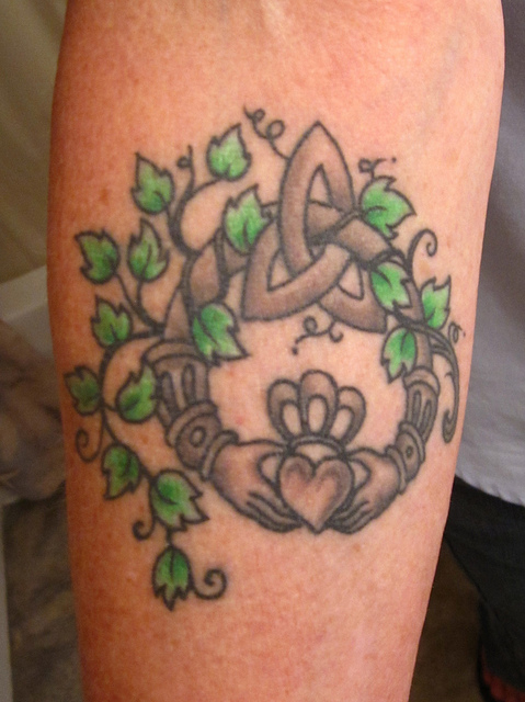 Beautiful Green And Black Color Ink Celtic Claddagh Tattoo With Green Leaves For Boys
