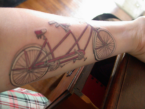 Best Ever Black And Red Color Ink Forearm Cycle Tattoo Design For Boys