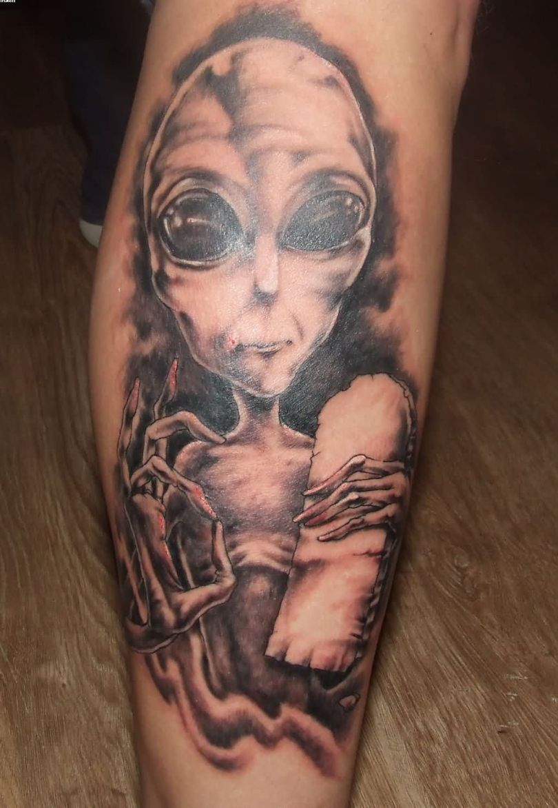 Best Ever Black And Red Color Ink Ugly Alien Tattoo On Leg For Boys