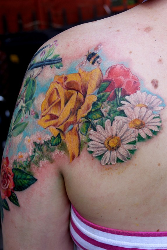 Best Ever Red Green Black And Yellow Color Ink Bumblebee Tattoo With Flowers On Shoulder Back For Girls