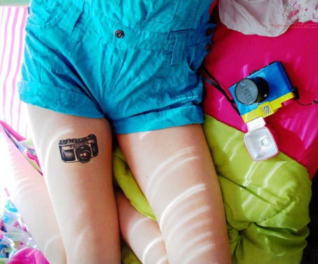 Brilliant Black Color Ink Photography Camera Tattoo On Thigh For Girls
